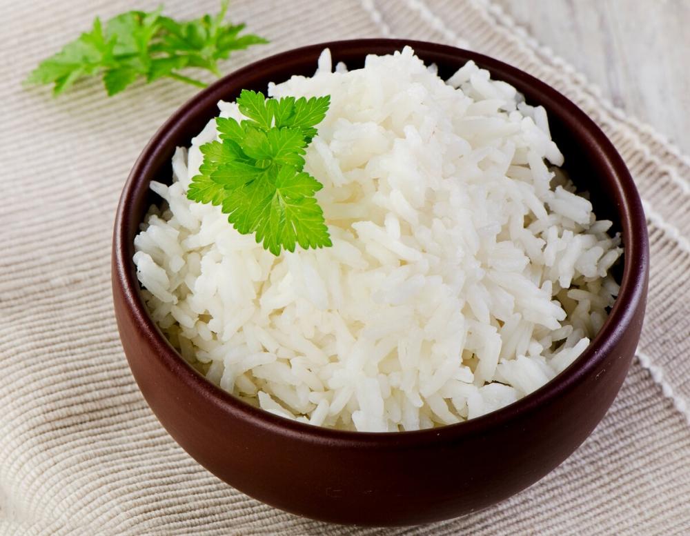 Сколько килокалорий содержится в 100 граммах риса?